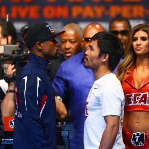 May 1, 2015; Las Vegas, NV, USA; Floyd Mayweather (left) stares at Manny Pacquiao during weigh-ins for the upcoming boxing fight at MGM Grand Garden Arena. Mandatory Credit: Mark J. Rebilas-USA TODAY Sports ORG XMIT: USATSI-225088 ORIG FILE ID:  20150501_mjr_su5_005.JPG